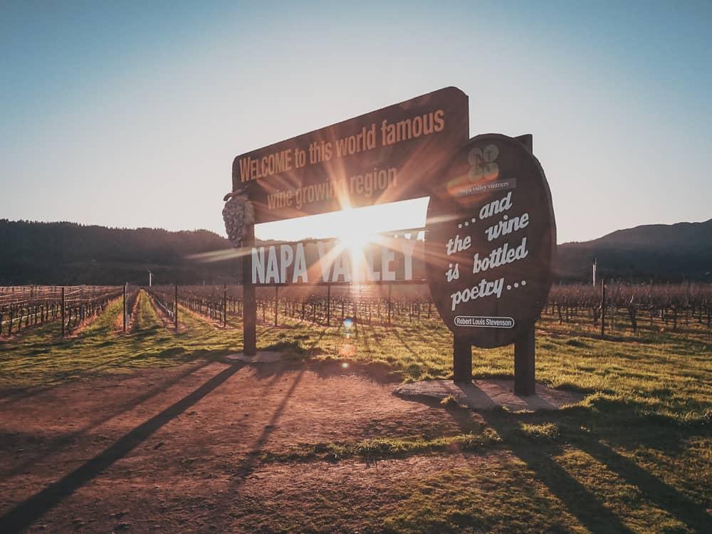 Sun shining through the welcome sign to Napa Valley California