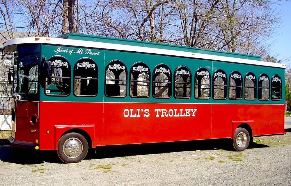 The vibrant red and green Oli's Trolley in Bar Harbor, Maine.