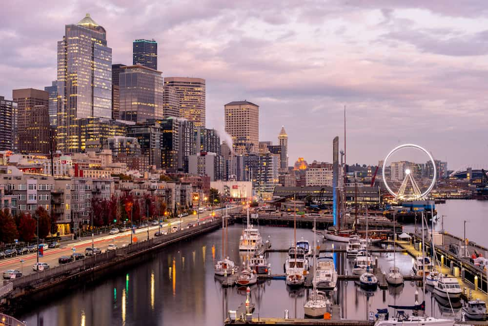 The harborfront area of Seattle at sunset.