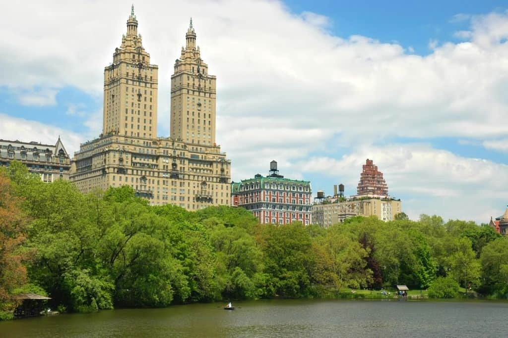 View of historic apartment buildings from a pond in Central Park on the upper west side of NYC.
