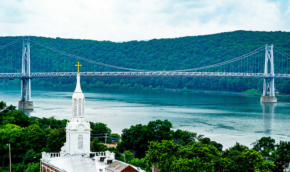 View from the Walkway Over the Hudson in Poughkeepsie with the Mid-Hudson Bridge in the background.