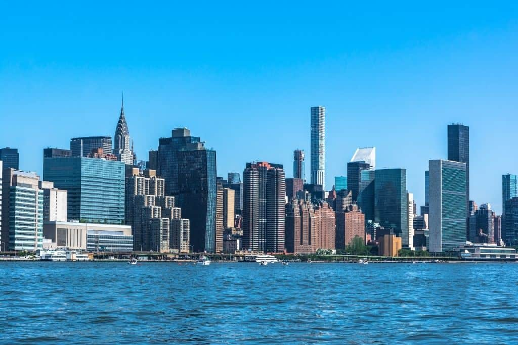 View of the Manhattan skyline from the East River since a ferry is one of the best things to do on the Upper East Side NYC