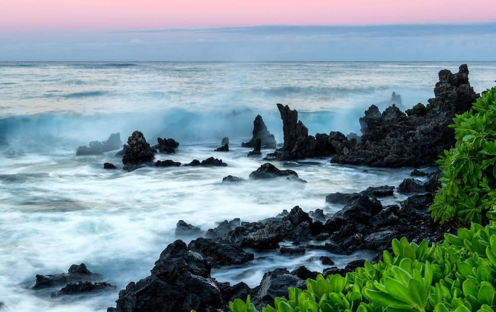 Waves crashing on the coast of Kona Hawaii at Twilight. The warmest place in US in December.