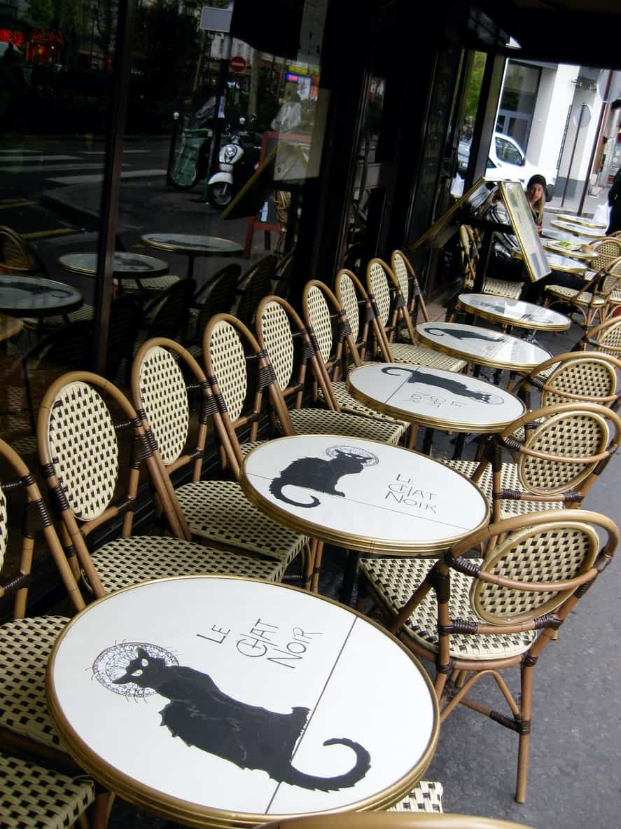 Tables at Le Chat Noir with the famous black cat logo on them.