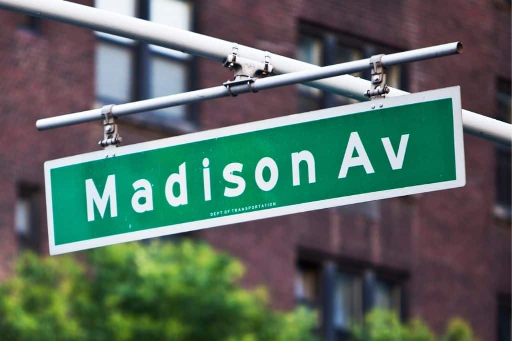 Green street sign for Madison Avenue in NYC