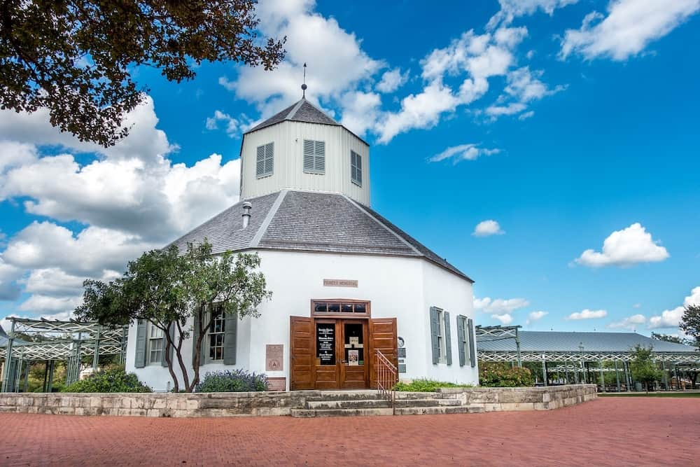 White exterior of the Vereins Kirche Museum in Fredericksburg, Texas, warm places in US