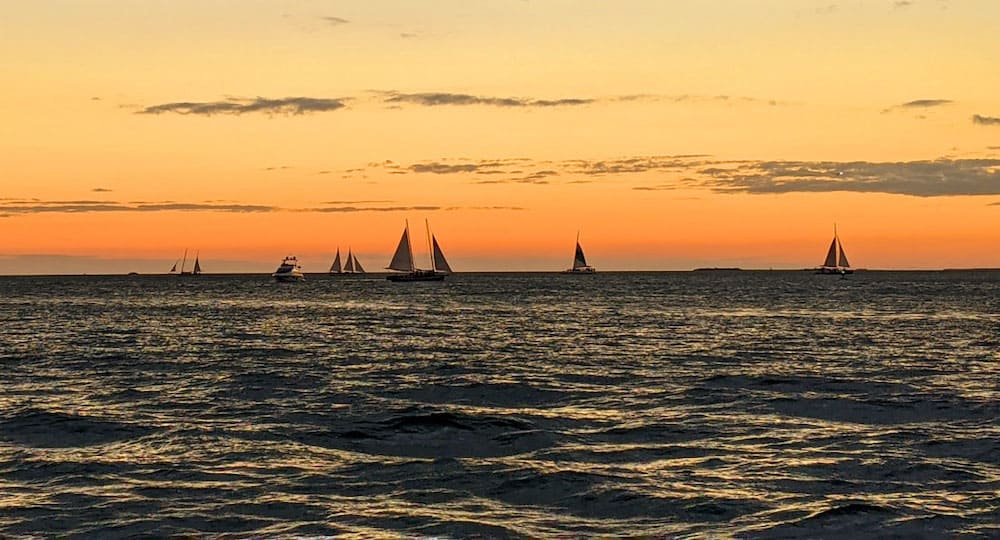View of boats sailing on the water from Mallory Square in Key West.