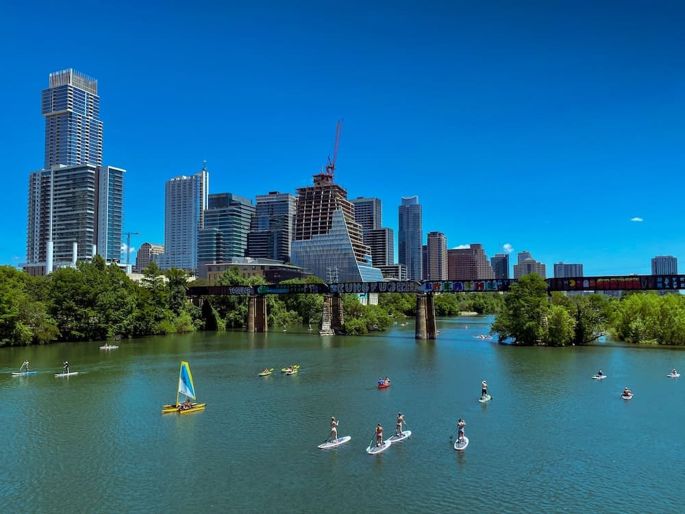Aerial view of people paddle boarding on the river in Austin, Texas.